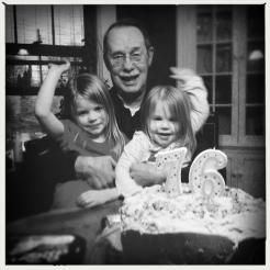 On his seventy-sixth birthday, with his great-granddaughters and banana cake. 2012.